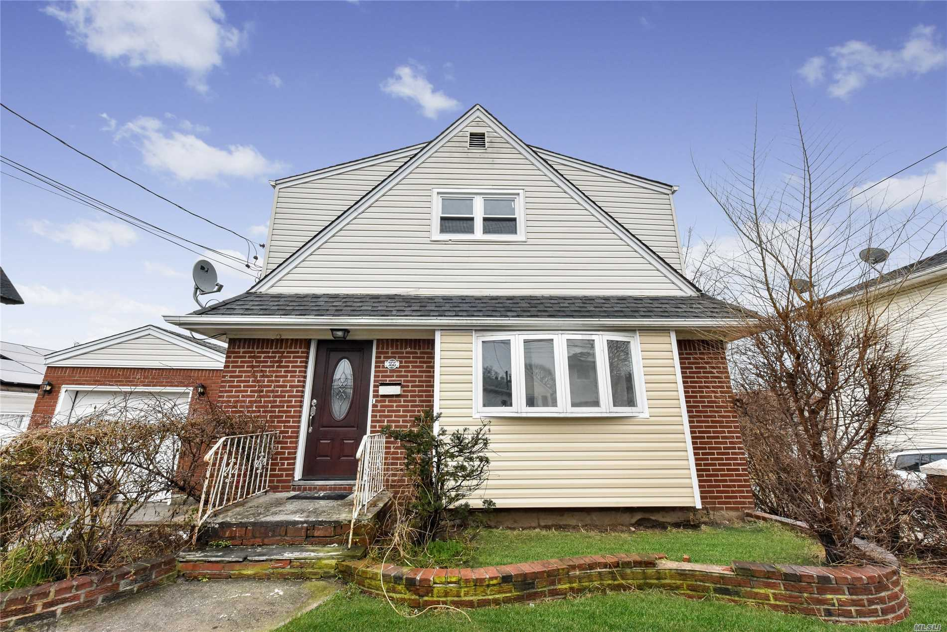 Elmont. Huge One Family Cape With 3 Levels With Room For Mom And Dad. New Kitchen, New Bathrooms, New Appliances And More. Hard Wood Floors Throughout. Tile Finished Huge Basement With High Ceilings And A Separate Entrance To The Basement.