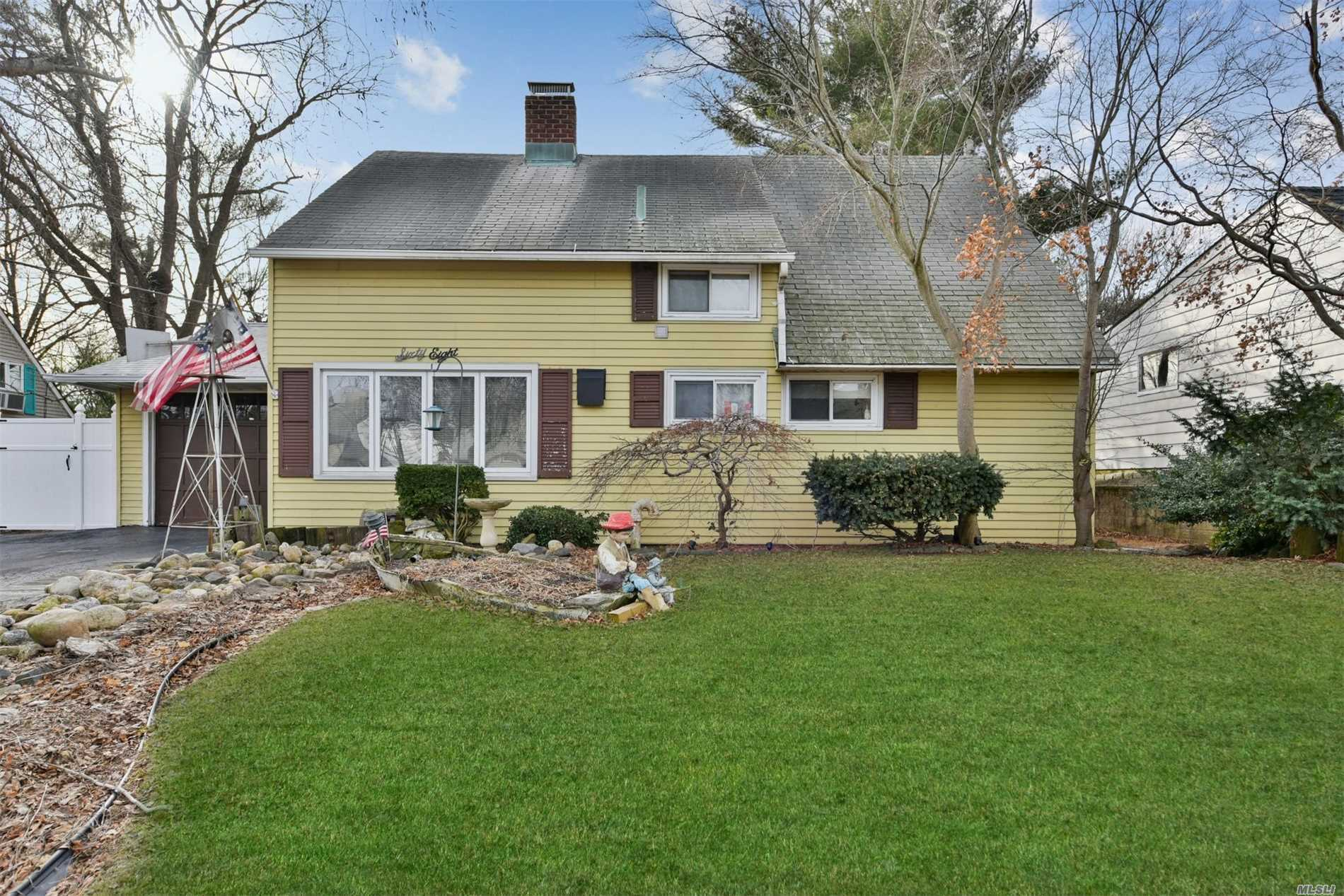 Great Expanded Cape With Rear Dormer And First Floor Extension In Island Trees Section Featuring 4 Bedrooms, 1.5 Baths, Eat In Kitchen, Dining Area, Extended Living Room W/ Wood Burning Stove, Rear Dormer, Screened In Porch, Attached Garage, Oversized Yard