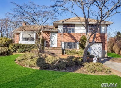 Property Lovers! Rare Expanded Brick Split Level With 4 Bedrooms Up Situated On Parklike 76X191 Private Setting. Rear Family Room Extension With Wood Burning Fireplace. Some Hardwood Floors, Double Closets, Gas Hot Air Heating Gas Cooktop, Gas Dryer. Inground Sprinklers. Generous Living Space. Master Bedroom Suite Has Shower Full Bath. Attached Garage And Unfinished Basement.