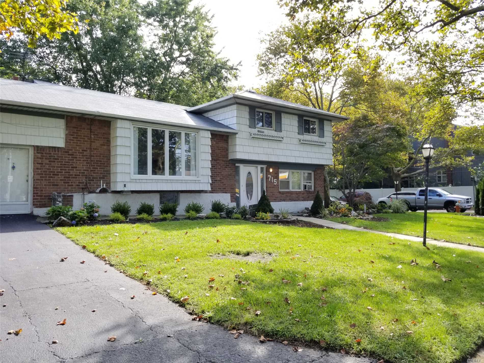 Newly Updated Split Level In Commack School District. 4 Bedroom, 2 Bath. New Kitchen, Bath, Carpet And Floors. New Landscaping. Updated Elec 200 Amp, Newer Cesspools And Burner, Great Professional Location For Dr., Atty., Daycare, Etc.