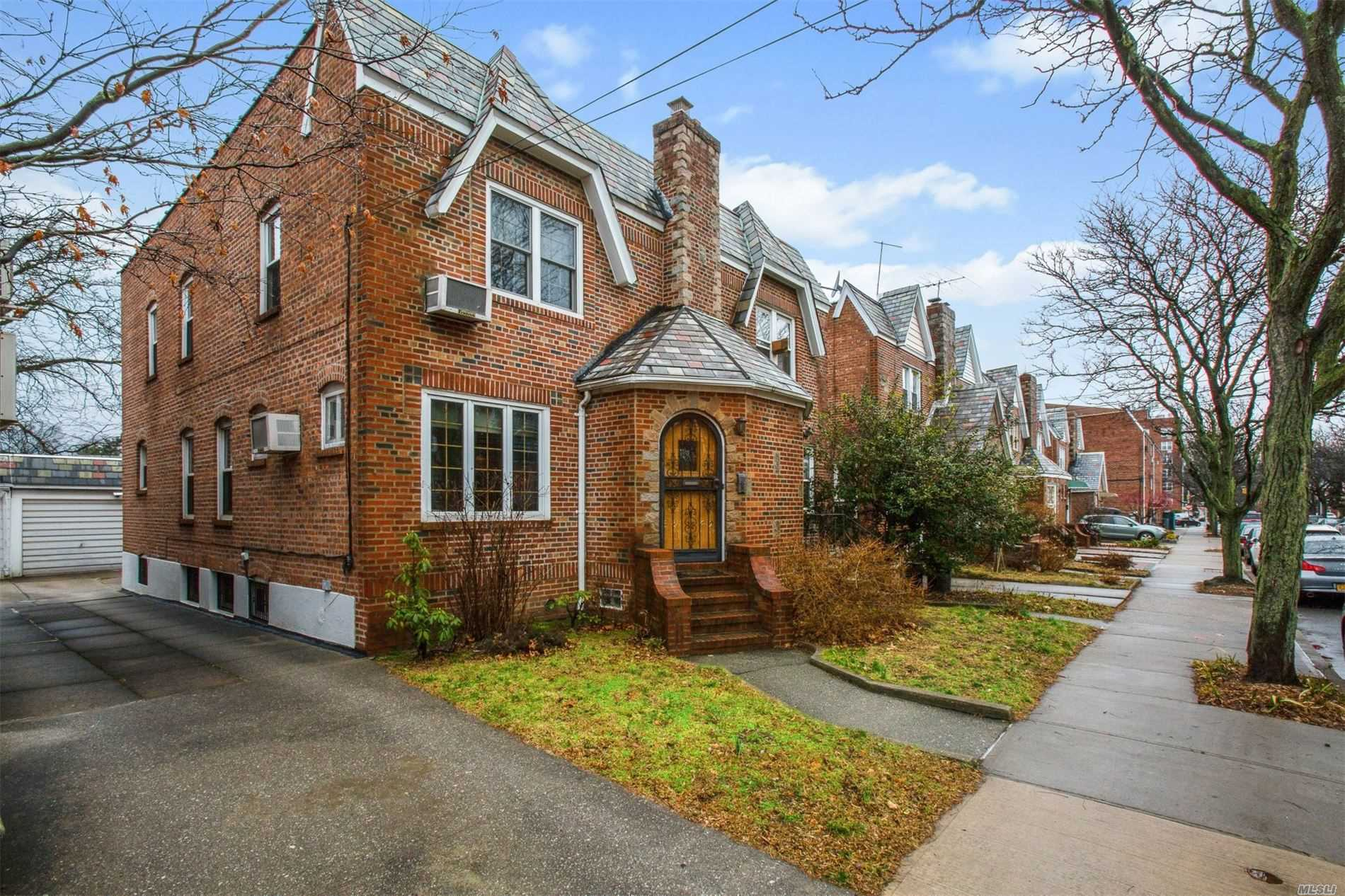 Charm, Community, Convenience!!! Nestled In The Beautiful Enclave Of Rego Park, This Charming Tudor Is Situated On One Of The Town's Prettiest Tree-Lined Streets, Offering You An Excellent Location, Desirable Layout, Rooms Proportionate In Size & Great Value! Additional Features Include Jacuzzi Bath, Recreation Space And Laundry, 1 Car Garage, A Rear Porch & Garden! A Must See For This Immaculate Home!