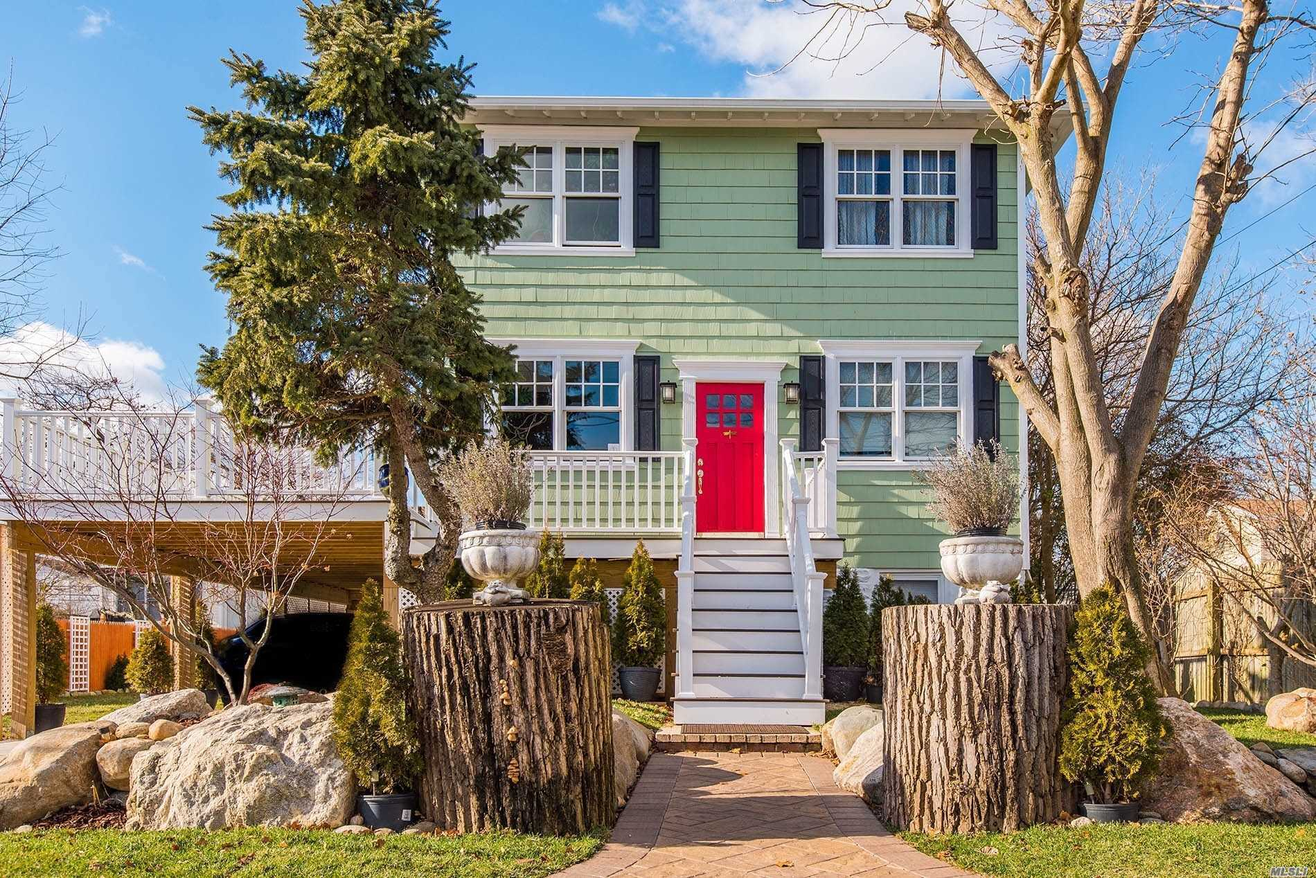 Newly Updated Colonial Features Hardwood Throughout, A Master Bedrm W On Suite & Balcony,  2 Queen Bedrms & Office. Gas Fireplace,  Cac, & Expansive, Open1st Fl,  Kitchen W Dual Sinks Lead To The Enormous 3 Tiered Decks W Ocean Views. Quaint Harmonious Yard Is An Invitation To Join Nature & The Outdoors. Surrounded By A Fish Pond, Private Beach Club, Fishing, Bathing, Boating & Sound Beach Rights, 13 X 40 Carport