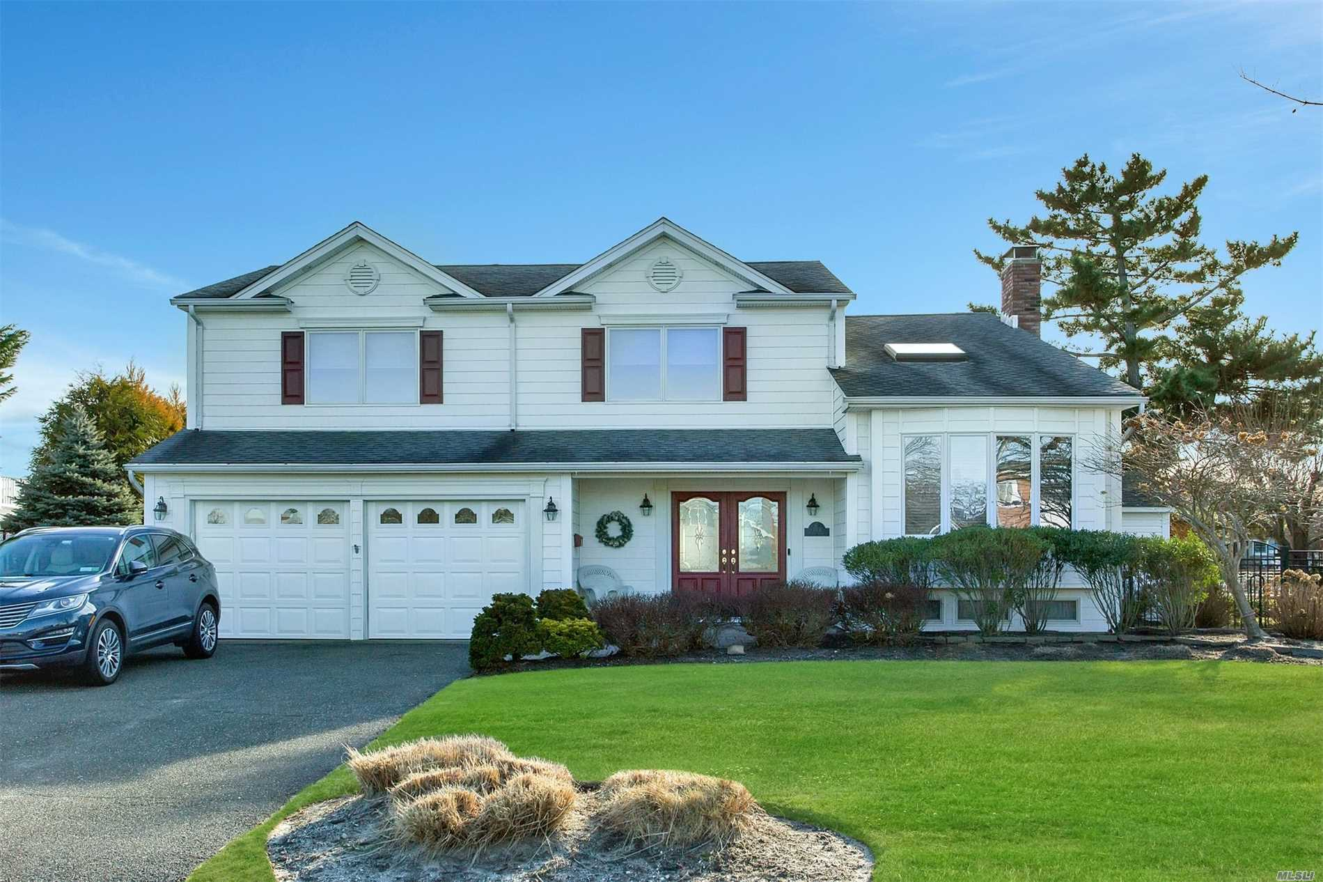 Beautifully Renovated Waterfront Colonial Splanch In Captree Landings W/80'Of Bulkheading & 24' X 40'Igp. Ef W/Porcelain Tile, 1/2 Bath, Fdr, Eik Redone In 2007 W/Porcelain Floor, Granite Counters, Cherry Cabinets & Ss Appliances, Laundry Area Into 2-C Garage.2nd Fl Has Living Room W/Cath Ceiling & Skylight. 3rd Floor Has Mbr W/New Mbth, 3 More Brs & Redone Bath W/Air Tub.