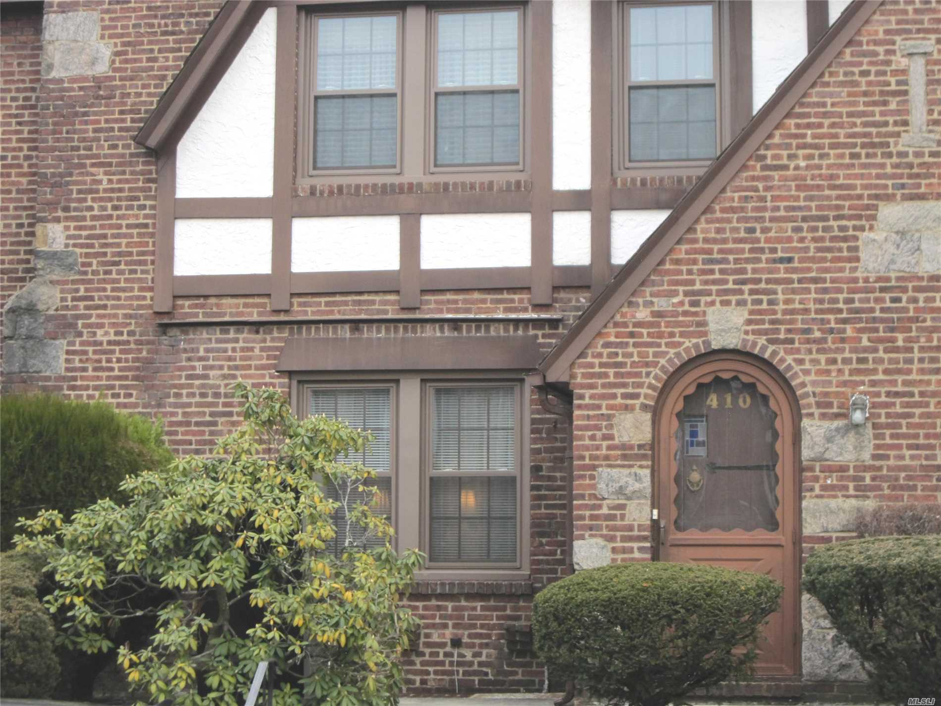 Charming, Bright Tudor Featuring High Ceilings And Beautiful Wood Floors Throughout. Large Living Room With Fireplace And Beautiful Formal Dining Room, Perfect For Entertaining. Meticulously Maintained With Gas Heat And New Windows. Ample Storage. Near Restaurants, Shopping, Hospital And Lirr.