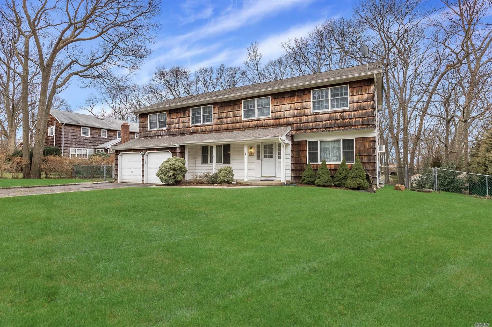 Spacious 5 Bedroom 3 Bath Center Hall Colonial Offers Gleaming Hardwood Floors, Den With Brick Fireplace, Huge Formal Dining Room, Master Bedroom With Private Bath. Full Finished Basement, 2 Car Garage, Tranquil Backyard With New Patio & Fire Pit. Located In 3 Village School District.
