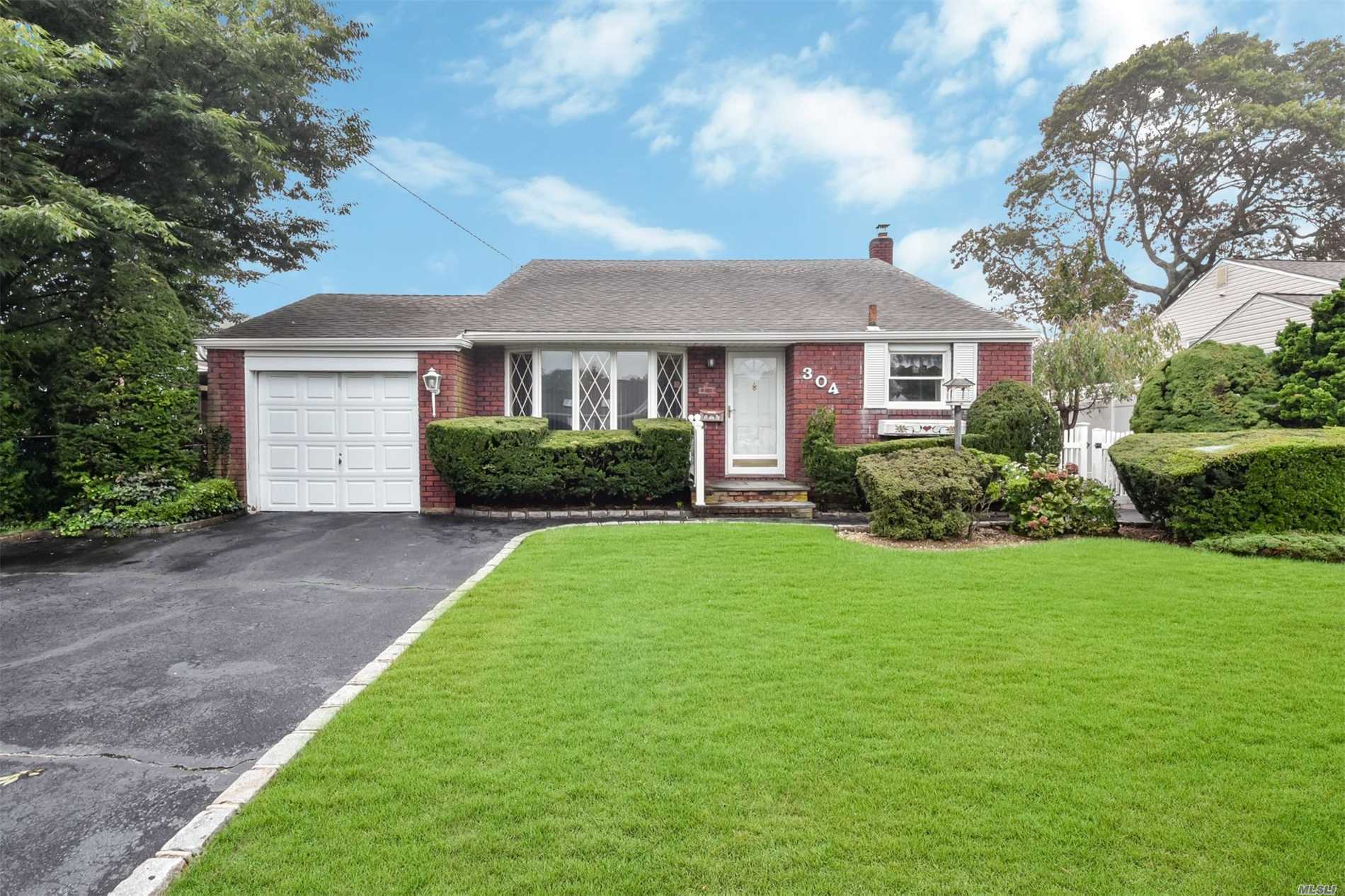 Lovely Brick Split Level Home Located In The Heart Of Massapequa Park. This Home Features Hardwood Floors, 3 Year Cac, 2 Year Heating System, 100 Amp Svc, Eik, Living Rm, Dining Rm, Large Den, 2 Full Baths, Laundry & Utlities, 2 Car Garage, Fully Fenced Private Yard. Close To Schools, Shopping, Restaurants & Transportation.