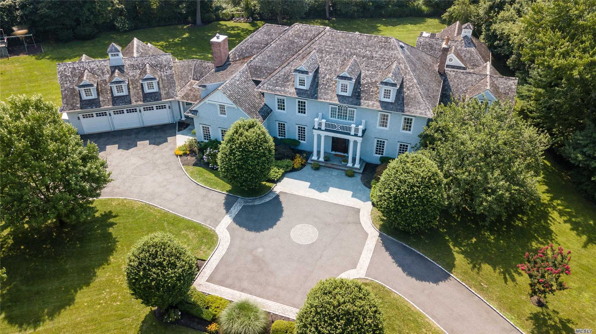 Stunning Shingle Style Residence Evokes Hamptons Beachfront Living. Custom Built To The Highest Standards. Beautifully Scaled Private Quarters & Every Desired Gathering Space. Spectacular Grounds With Pool, Pool House. Located On Cul-De-Sac In Prestigious Harriman Estates And Short Distance To Beach.