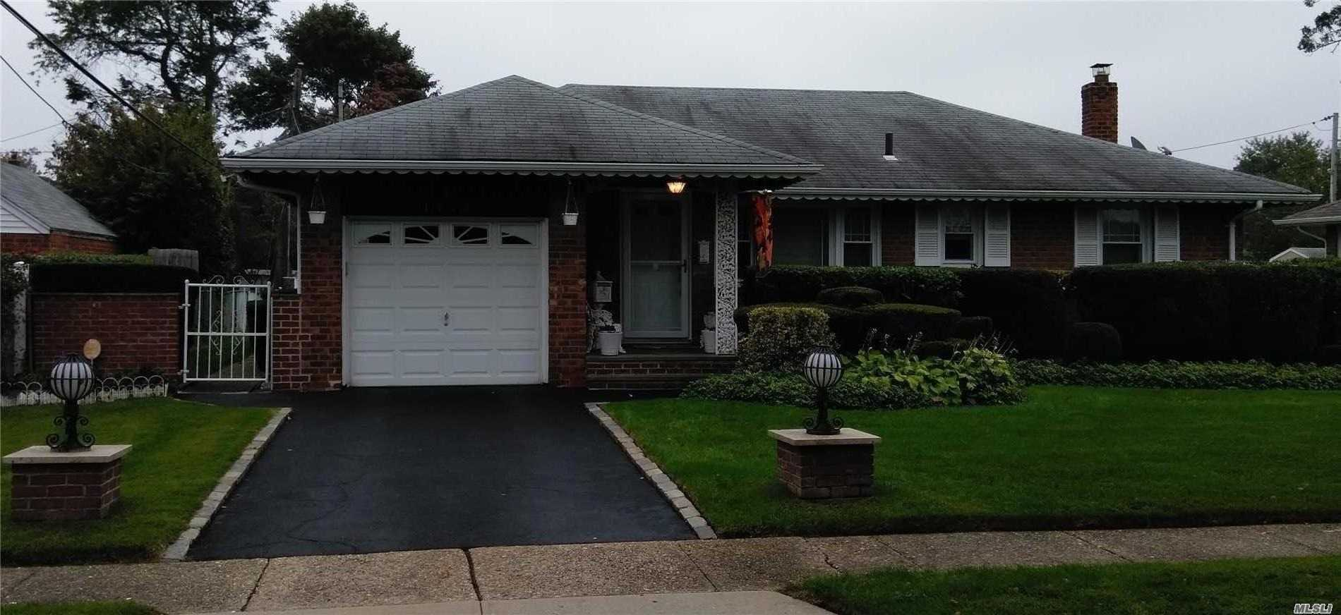 Beautiful Well Maintained All Brick Ranch Home In The Baldwin Oaks Community. 3 Bed Rooms, Huge Family Den, Large Back Yard. Very Large Full Finished Open Space Basement With High Ceiling, And Large Bar, Washer And Dryer Area And Half Bath. (Hard Wood Floors Beneath Carpet. Except Den And Basement)