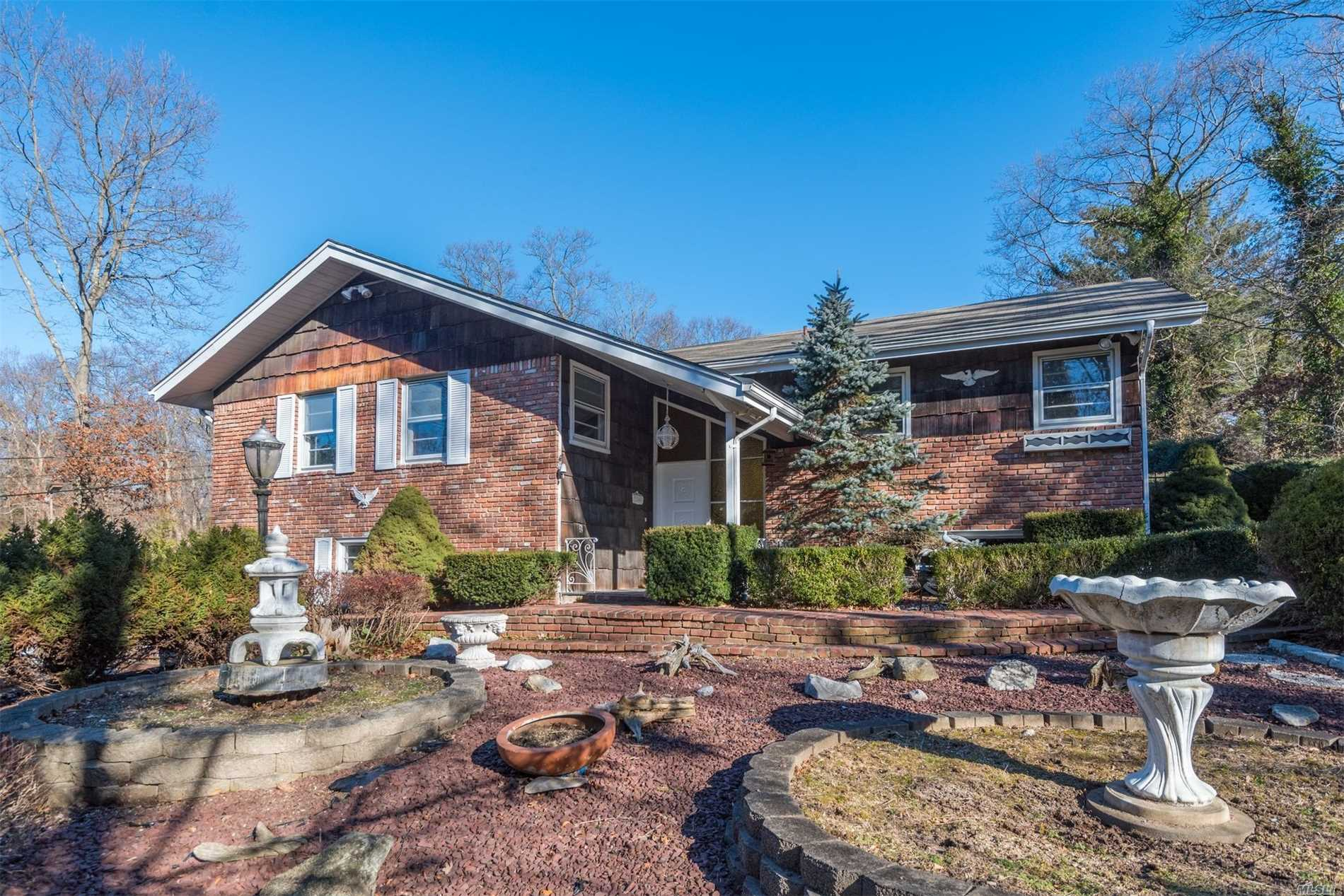 This Great Custom Built 1959 Hi-Ranch Is For The Buyer That Wants To Be On Top Of The World. With 1.75 Acres Of Property It's Probably One Of The Highest Points On Long Island. The House Is Surrounded By Brick Patios And Walkways. There Is A Paved Belgian Block Edged Driveway That Runs Up To The Top Of The Property. Up Past The House Is A Large Two Car Garage With Shed Attached That Is Currently A Wonderful Wood Shop, But Could Be An Artist's Studio Or Collector's Garage. Truly A Special Place.