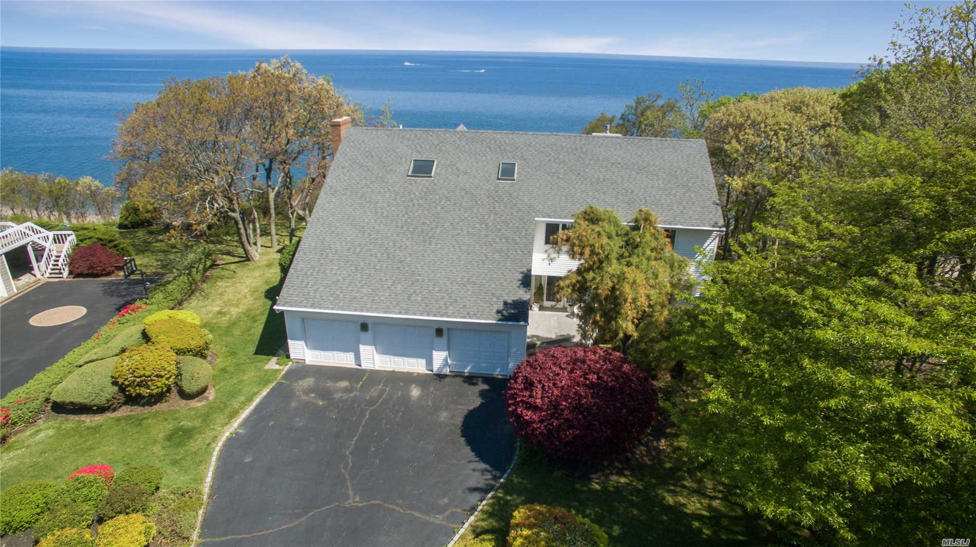 The Sound & Surf Are A Backdrop To This Extraordinary Waterfront Custom Built Home! Soaring Ceilings/Windows Galore/2 Brick Fireplaces/Cvac/Cac/Oak Floors/Observation Deck From Mbdrm/3 Car. Located In A Prime Waterfront Community W/Access To Pvt. Beach. New Secure Bulk Heading Maintained By Beach Association. Buy The Sound!! Note: Study Can Be 4th Bedroom On 1st Level.