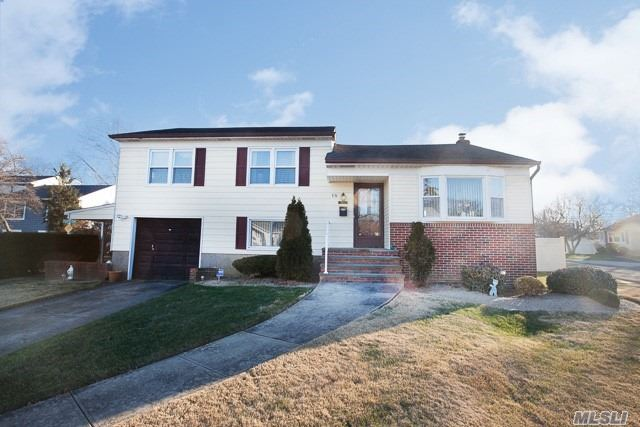 Beautiful Split Level Situated On Quiet Block In Prime West Farmingdale, Great Curb Appeal W/ Brick & Vinyl Sided Exterior, Lr W/ Refin Hrdwd Floors, Dr W/ Refin Hrdwd Floors & New French Sliding Doors To New Deck, Updated Eik W/ Oak Cabinets & New Refrigerator, Mbr W/ Fbth & Wic, All Windows Replaced, Alarm, 150 Amps, Privately Fenced Backyard, Covered Patio, New Deck, Northside Elem., Convenient To All Transportation & Shopping. **Tax grievance filed**