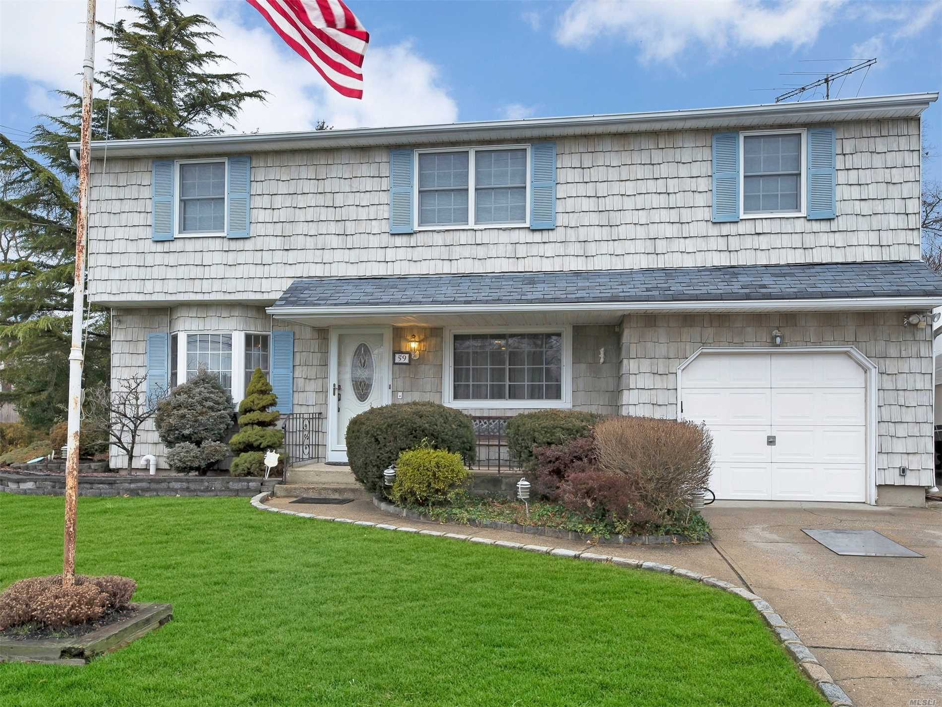 Beautiful, 5 Bedroom Meticulously Maintained Colonial With Office And Sunroom This Home Sits On A Well-Manicured Corner Lot In A Quiet Neighborhood. A Perfect Home For A Growing Family.