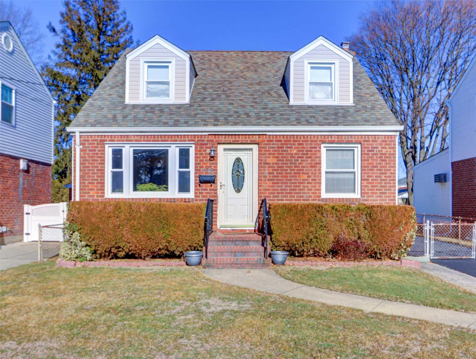 Wide Lane Cape Brick House, 4 Bedrooms, Living Room, Formal Dinning Room, New Kitchen, 2 New Full Bath, New Roof, Detached Car Garage, Full Finished Basement, Laundry Room, Walk-In Closets.