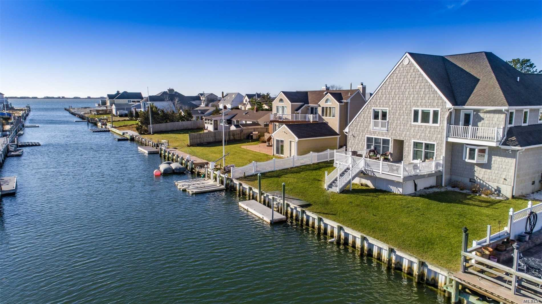 Hamptons Waterfront Retreat With Gorgeous Shinnecock Bay Views And 75' Of Navy Bulkhead.This Stunning 3500 Sq Ft Shingled And Stone Residence Offers A Double Height Entry, Open Floor Plan, Chefs Kitchen And Expansive Deck For Outdoor Enjoyment. Huge Family Room Which Can Easily Convert Into A 1st Story Bedroom. Upstairs You'll Find Master And Junior Suites, 2 Additional Bedrooms, 3 Baths And Waterside Balcony. Travel By Land Or Sea To This Stunner, But Hurry, Summer Is Just Around The Corner!