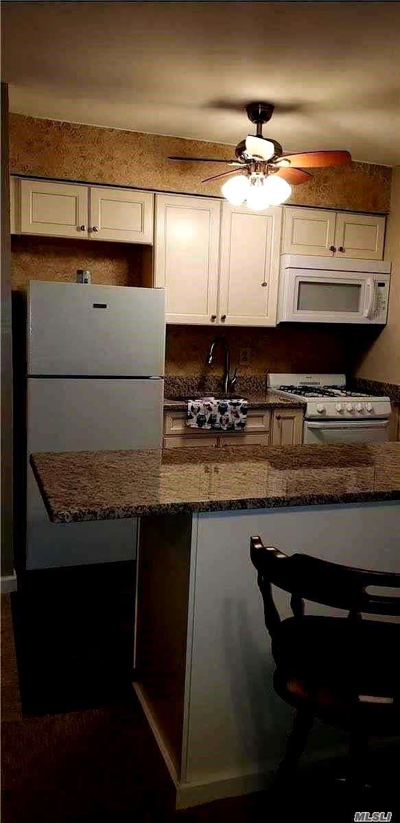 2nd Floor Walk Up, All New Carpet, Paint, Moldings, Kitchen Cabinets, Sink, Granite Counter Tops, New Kitchen Ceramic Tile (Looks Like Wood), Updated Bath, 3 Large Closets, Queen Size Bedroom, Units Parking Spot A Door Away, Windows, Terrace Less Than 5 Yrs Old, New Roof.