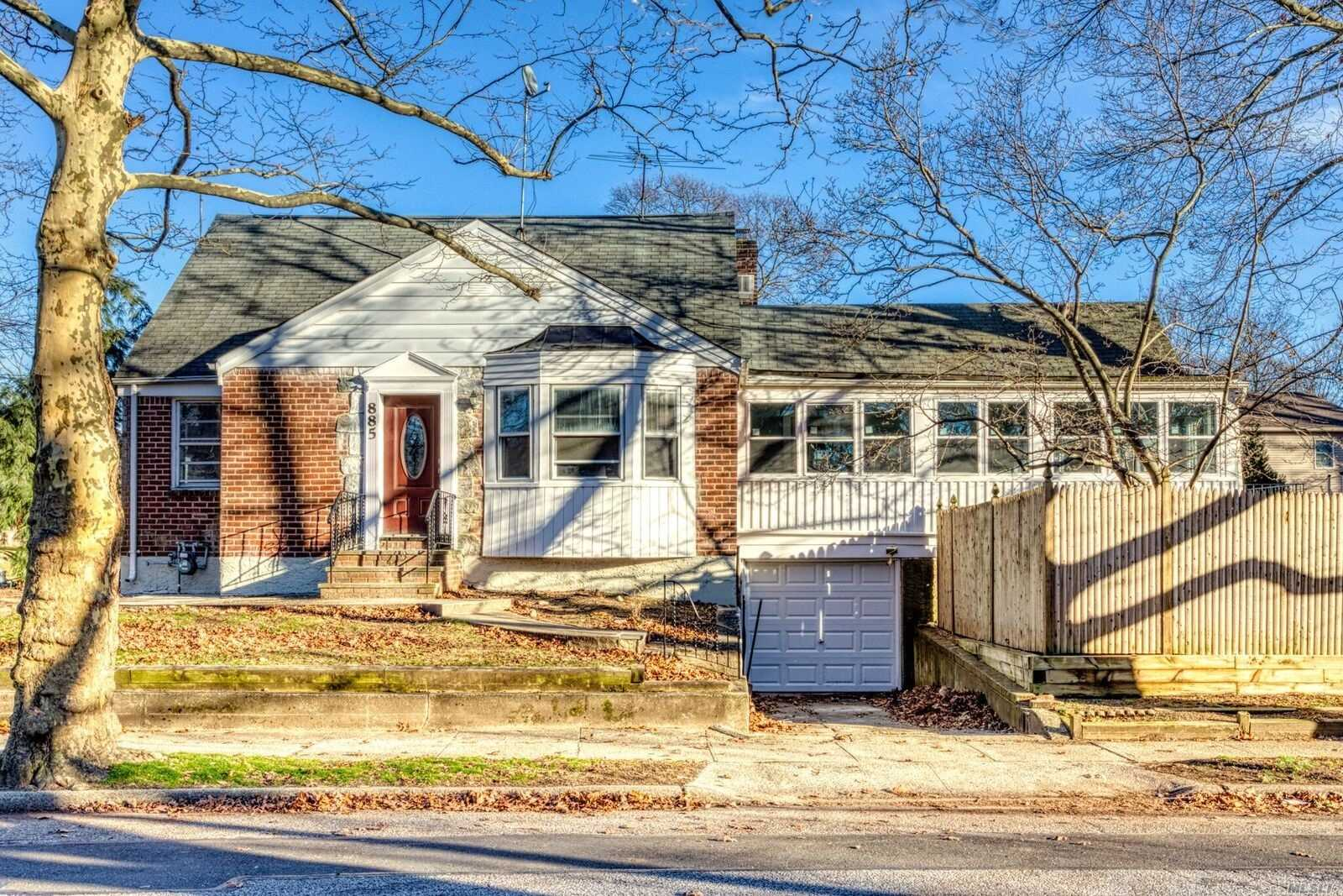Totally Redone Cape W/Granite And Wood Kitchen, Main Floor Family Room. Beautiful Finished Basement, Sun Porch And Harwood Floors.