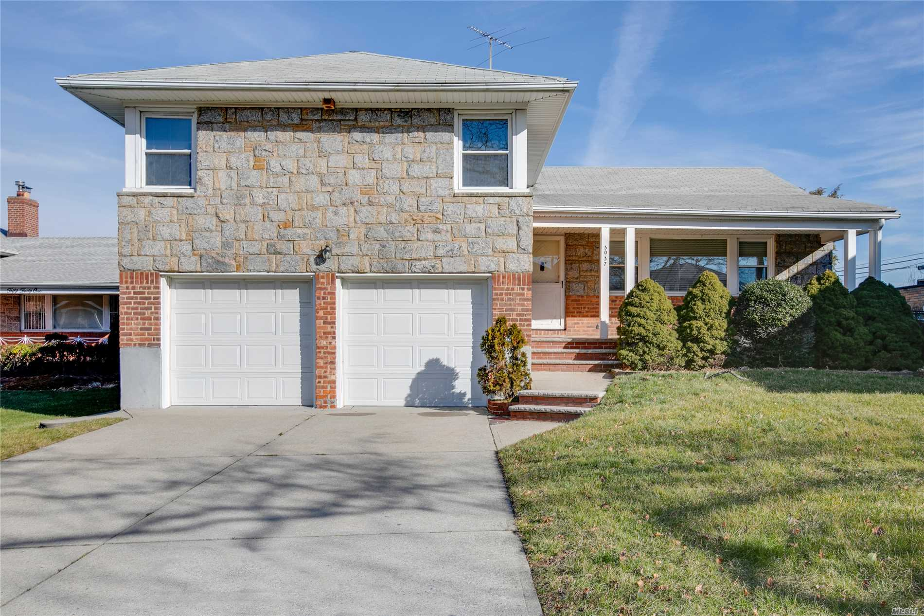 Beautiful 4 Level Split House, Large Lot 66.5' X 150' , Building Size 45X41.33, Prime Bayside-Oakland Gardens Location! It Features: 3 Bedrooms, 2.5 Bathrooms. Spacious Living Rm & Formal Dining Rm, Eat In Kitchen, Lower Level Family Rm. W/Working Fireplace, 2 Car Garages. Finished Bsmnt, Lots Of Storage, In Ground Sprinkler, Beautiful Back Yard. Near Parks, Shops, Major Highways, Excellent School District #26. Ps203, Cardozo High School. (Potential To Rebuilt Giant Mansion W/Plan).