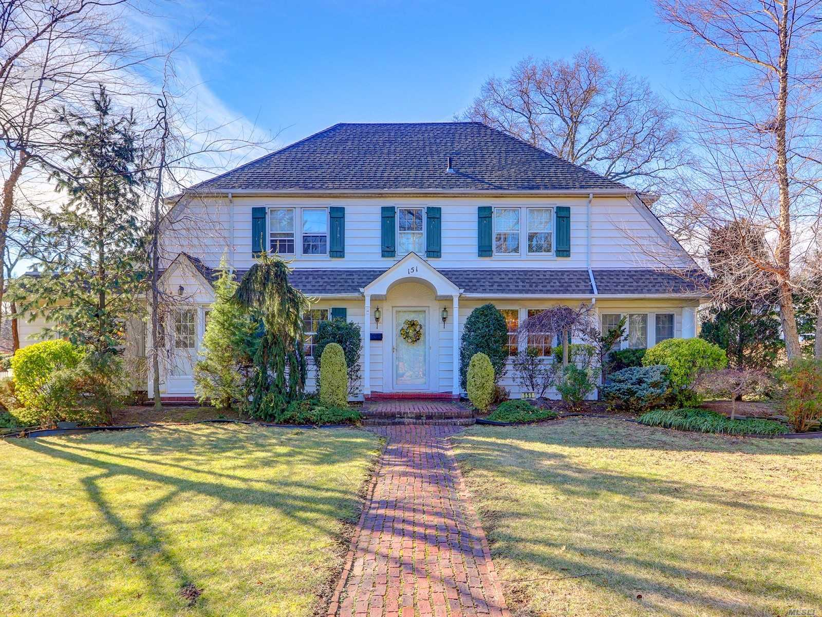 Don't Miss This Spectacular Center Hall Colonial In The Desirable Cathedral Gardens Section Of Hempstead!!! A Grand Foyer, Living Room W/Fp, Formal Dining Room W/Built-Ins, Eat-In Kitchen W/Fp, Great Room, And 2 Powder Rooms Complete The 1st Floor. The 2nd Floor Features A Master Bedroom W/Bath, 3 Addl Bedrooms, Hall Bath And Staircase To 3rd Floor Attic. Impressive 100 X249 Lot Is Ideal For A Future Inground Swimming Pool. Zoning Provides Various Permitted Uses.
