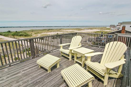 Keep The Lazy Days Of Summer In This Renovated Three Bedroom Beach House In Westhampton Dunes. Enjoy The Right Of Way To Both The Ocean Or Bay Beaches, Relax On Your Deck To Enjoy The Bay Views Or Sit On Your Roof Deck For The Best Ocean And Bay Views And Breezes. There Is Even A Fireplace On Those Rare Cool Summer Nights. Don't Miss Another Hampton's Sunset!