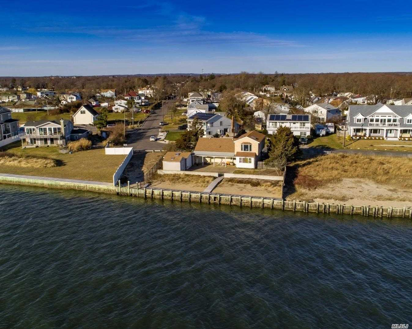Great Potential! Enjoy Spectacular Panoramic Views Of The Great South Bay And Fire Island. 2015 Updates Include: Roof, Wood Floors, Bath Room, Window, Doors, Hw Heater, Burner, Sea Wall Ect. 2016 Bulk-Heading With 10 Year Warranty.. View Attached Virtual Tour!