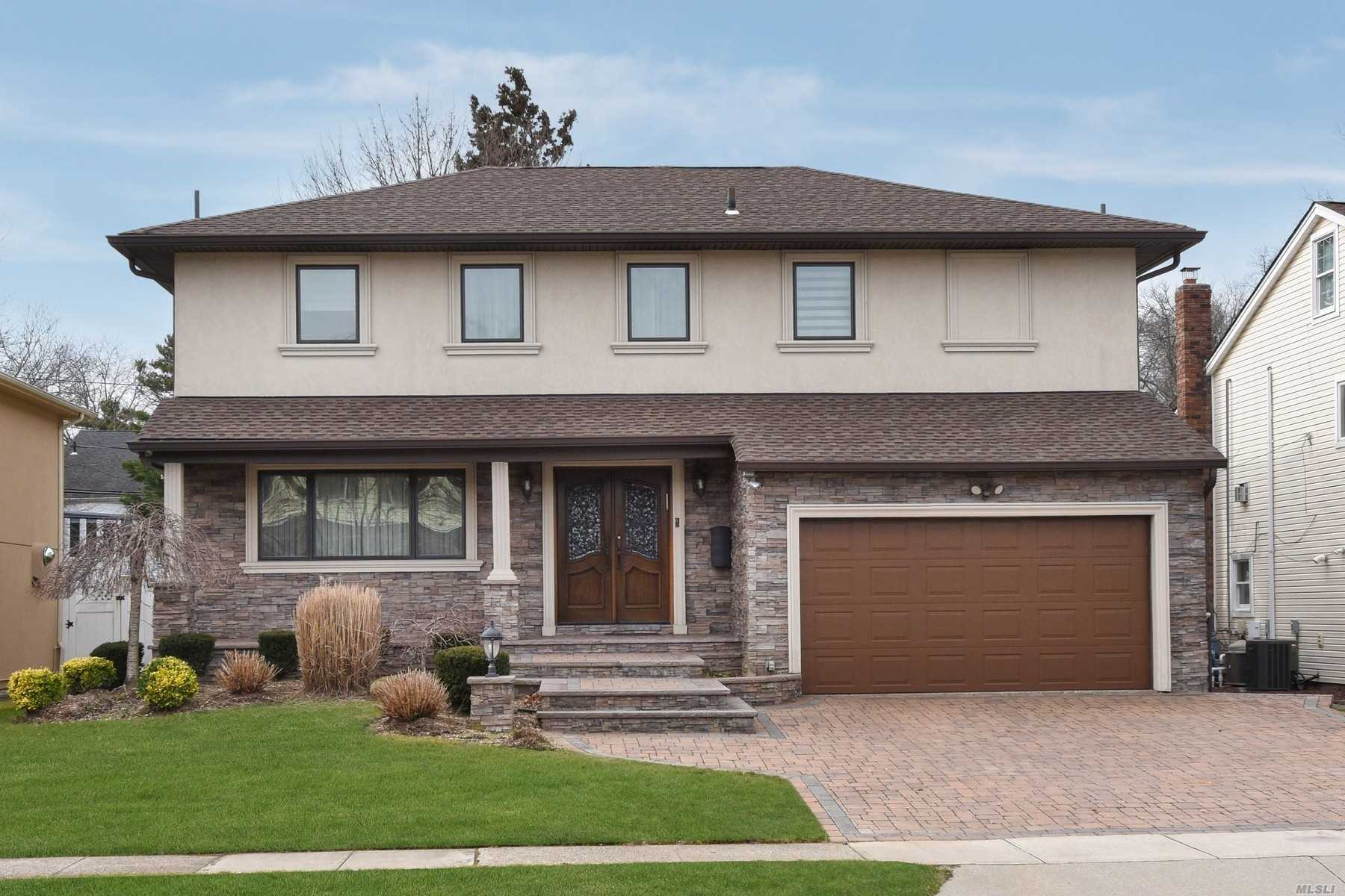 Welcome Into This Young Gut Renovated In 2010 5 Bedroom 3.5 Bath Colonial Home That Offer Gourmet Eik, Formal Drm That Extends Into The Living Rm, Beautiful Master Suite, Full Finished Basement With An Extra Brm And A Full Bath, Manicured And Paved Property... And Much More.