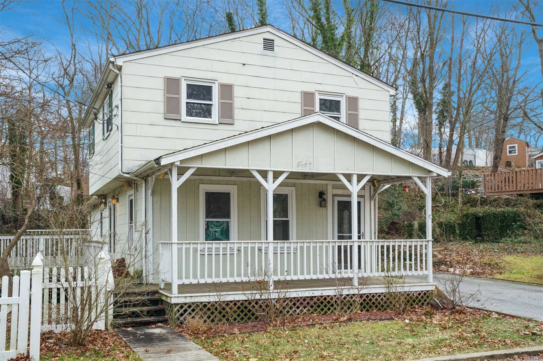 Rocking Chair Porch Overlooks Large Yard. Unique Colonial, Large Living Room W/Wood Stove, Granite Kitchen, New Baths, Newer Windows, Huge Deck, 200 Amp Electric. Short Walk To Private L. I. Sound Beach. Shed Is A Gift. Ready Now!