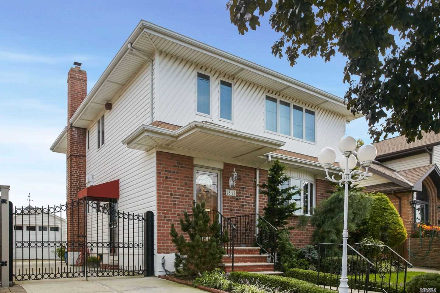 Beautiful 1 Family Detached Home On An Oversized Lot (40X95) In The Heart Of Midle Village Located On A Desirable Block (Penelope Ave). Modern Eat-In-Kitchen W/ Sub Zero Refrigerator, Formal Diningroom, Spacious Livingroom, 4 Bedrooms, Full Finished Basment, Garage, Private Driveway And Private Yard.