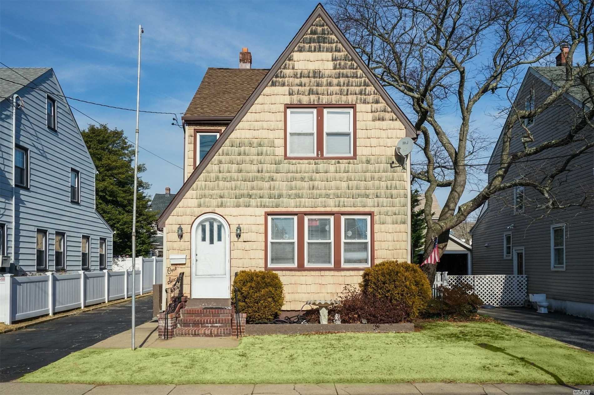 Bright And Sunny Legal Two Family In Heart Of West Hempstead. Laundry On Every Floor. Updated Baths, Kitchens, Roof And Boiler All Within The Last 5 Years. Basement Can Be Third Apartment. Detached 2.5 Car Garage Walking Distance To Train Station Low Taxes George Washington Elementary