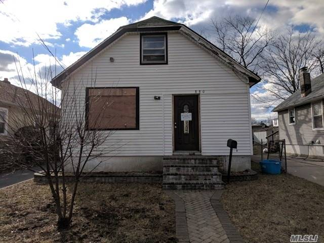 Centrally Located Cape Style Home In Need Of A Makeover! A Great Starter Home Or Fixer Upper For The Right Buyer At A Great Price That Leaves You W/ Tons Of Opportunities! Full Basement & Detached Garage Too!