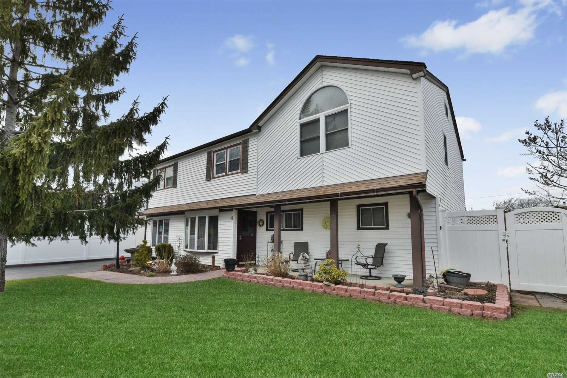This Large (Approx.2500Sq Ft) Updated Home Located On Prof.Landscaped Property Perfect For A Large Family Or Possible M/D With Proper Permits Features, Updated Eik And Baths, 6 Large Bedrooms, Arch.Roof, Pergo Floors, Crown Moldings, Gas Line Very Close By, 200 Amps, Convenient To All.
