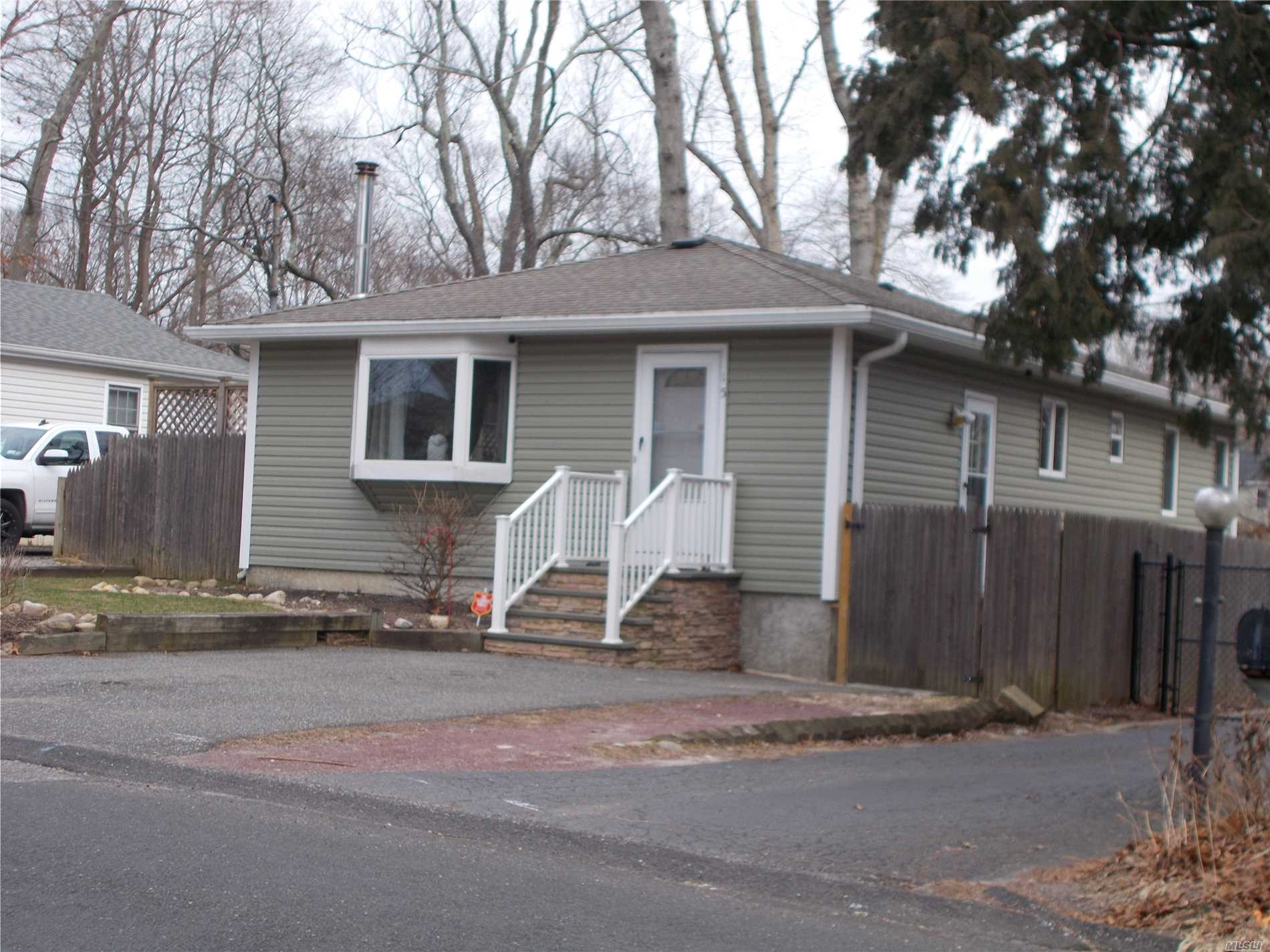 Spotless Home W/ New Roof And Siding, Large Deck W/ Hot Tub, Living Room W/ Wood Stove, New Kitchen, New Bath, Full Finished Basement W/Fbath And Ose. 200 Amp Service Just Move In