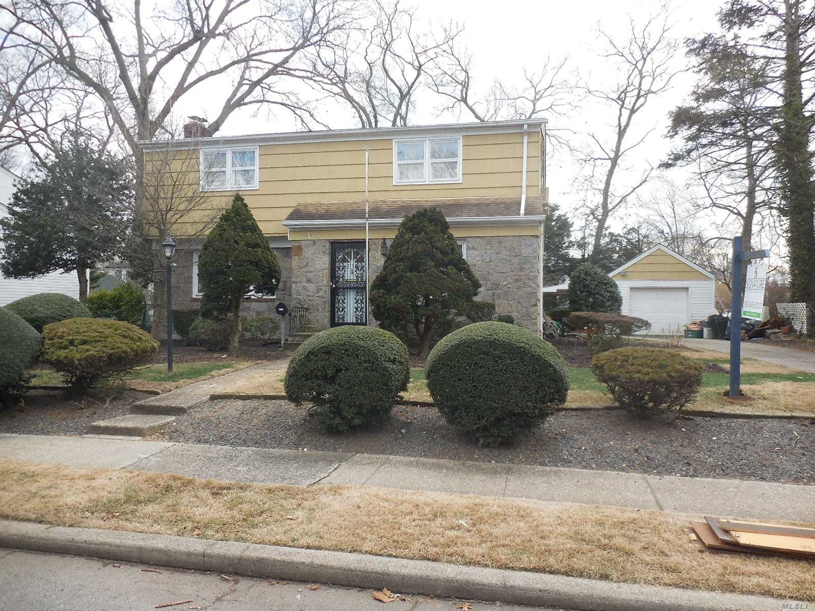 Attention Property Lovers! Expanded Cape In Prime Merrick Manor On Huge 75X125 Lot! Features Lr With Fieldstone Fireplace, Hardwood Floors, Basement W Outside Entry, All Large Room And More! A Little Tlc Will Make This A Showplace!