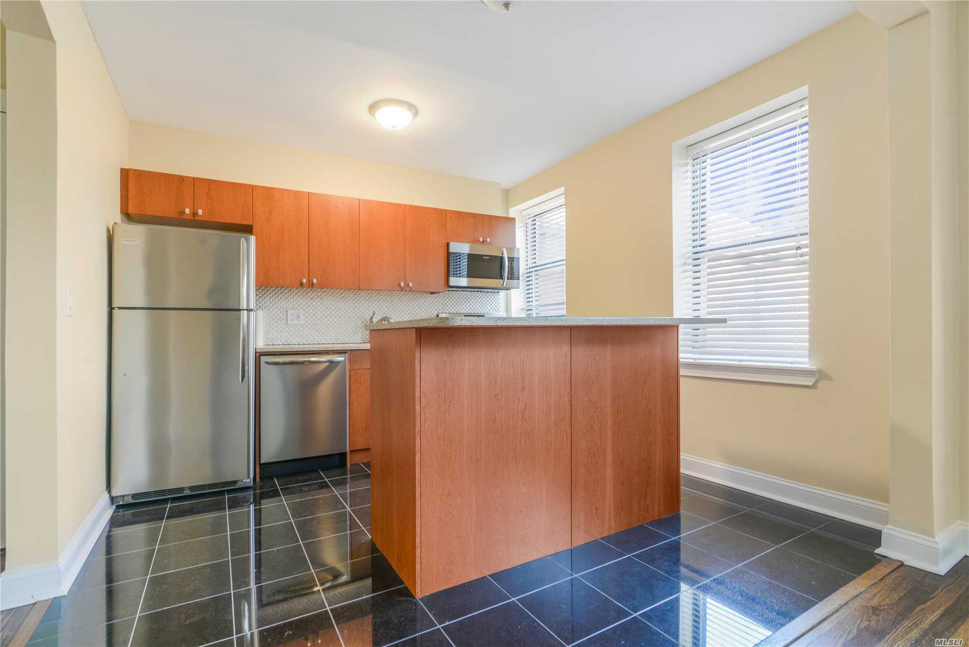 Spacious, Sunny Totally Renovated 4 Room (2 Bedroom ) Apartment Located On Top (Second Floor) Of Building. Refinished Wood Floors, Brand New Kitchen And Bath. True Move In Condition. Separate Basement Storage Room. Short Walk To Shopping.