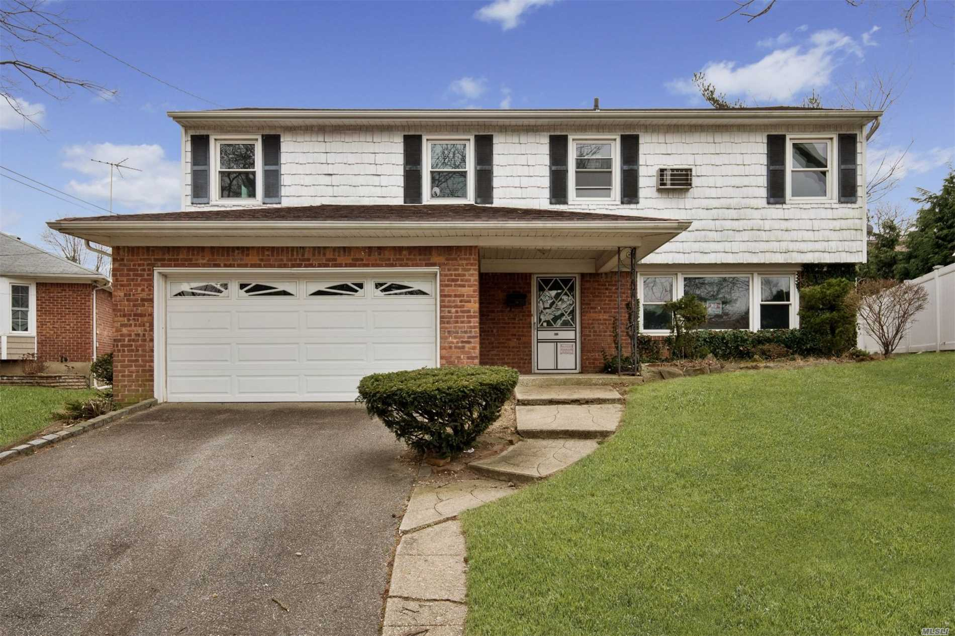 Over-Sized Split Level Home W/ A Fantastic Layout! Spacious Living Room W/Vaulted Ceilings Making It Feel Larger & Open Then It Is Along W/ A Brick Cozy Wood Burning Fpl & Sliders Leading To The Yard! Great Sized Eik W/ Potential To Create The Open Concept You've Always Wanted. 4 Generous Sized Bedrms & 2.5 Bathrms. This Home Has It All & Just Needs Your Personal Updates To Make It Home Sweet Home! Partial Basement & 2 Car Garage For Ample Storage. All This Located On A Quiet Cul-De-Sac!