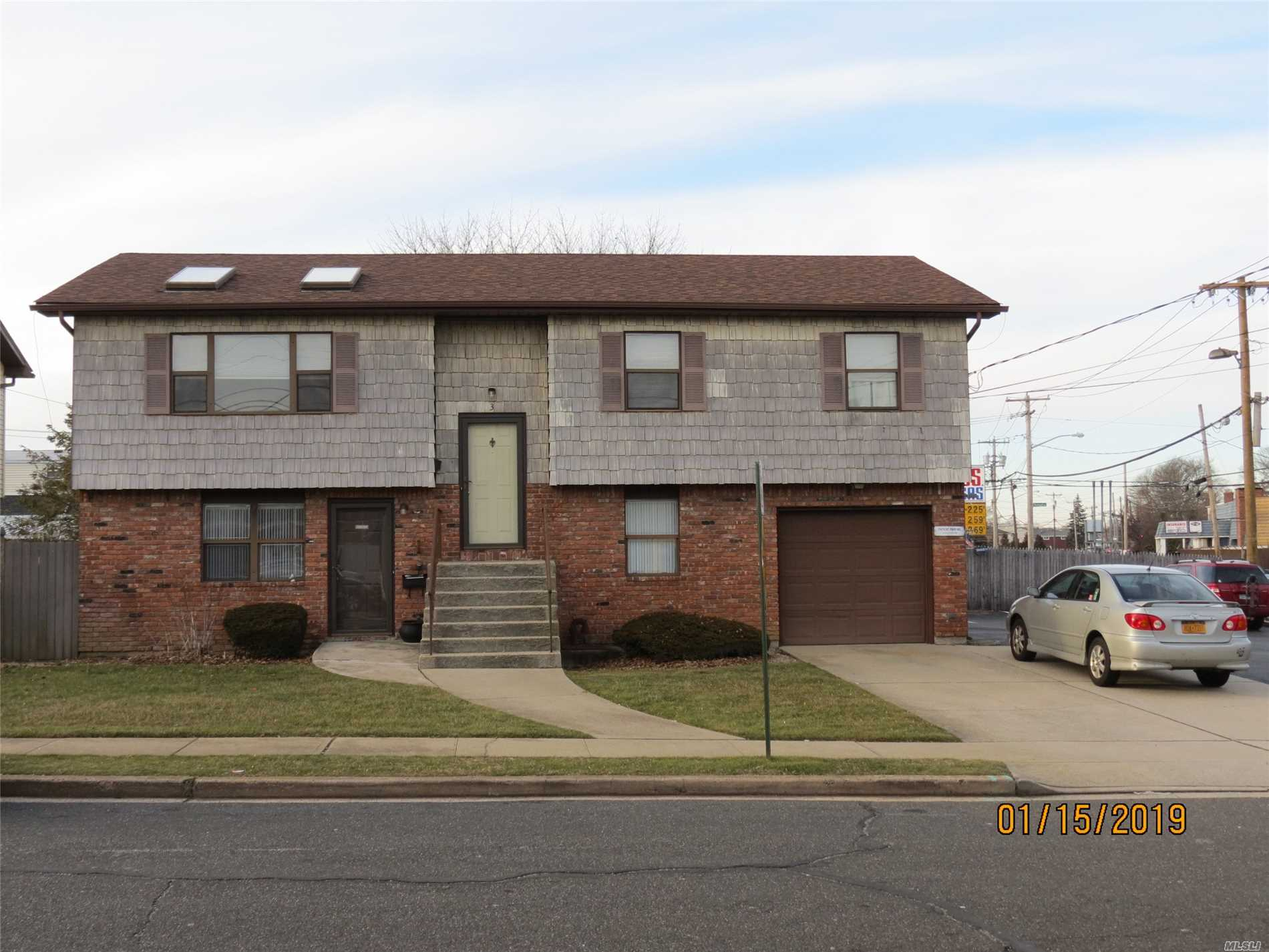 Opportunity Knocks With This Hi-Ranch. Great Location With Professional Office On Ground Level And Ample Parking. Full 3 Bedroom Apartment On Upper Level. Or Make It Your Own Dwelling! Permits Not Transferable. New Owner Must Re-Apply For Proper Permits.