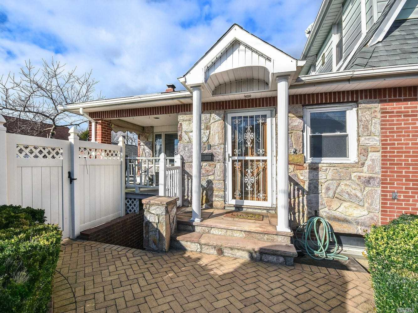 Meticulously Kept First Story Apartment Features Separate Entrance Into Bright And Spacious Living Room With Hardwood Floors And Sliders To Side Yard. Granite Eat-In Kitchen, Stone Living Room With Wood-Burning Fireplace, Master Suite With Bath, Two Separate Bedrooms And Laundry In Basement.