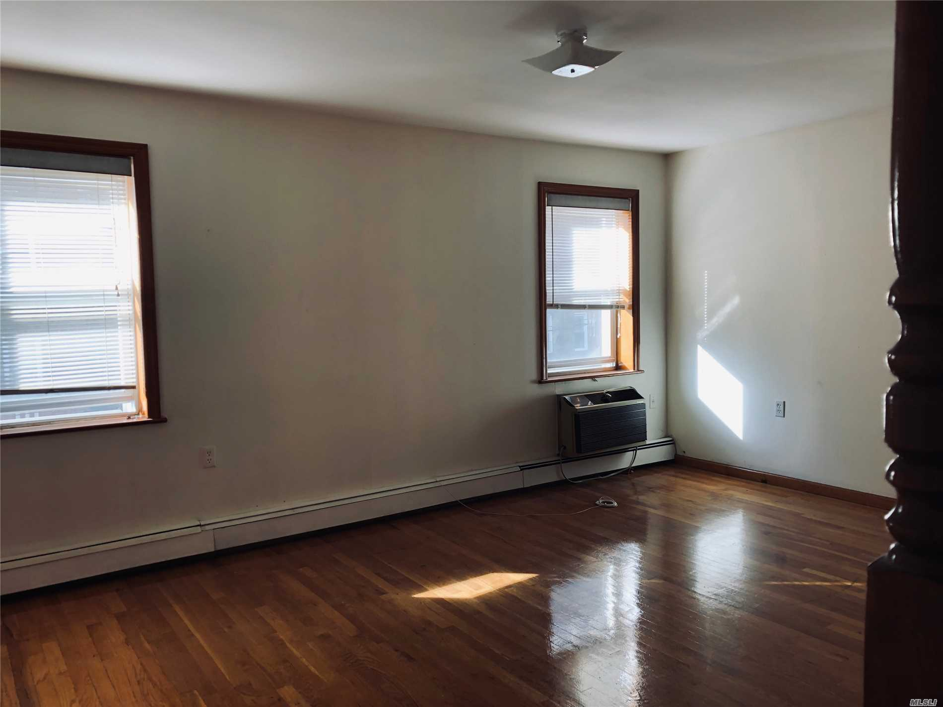 Rego Park Bright 2 Bedrooms In 2 Family House Near By Queens Blvd. Very Close To R/M Train Station. Shopping, School, Convenient To All.