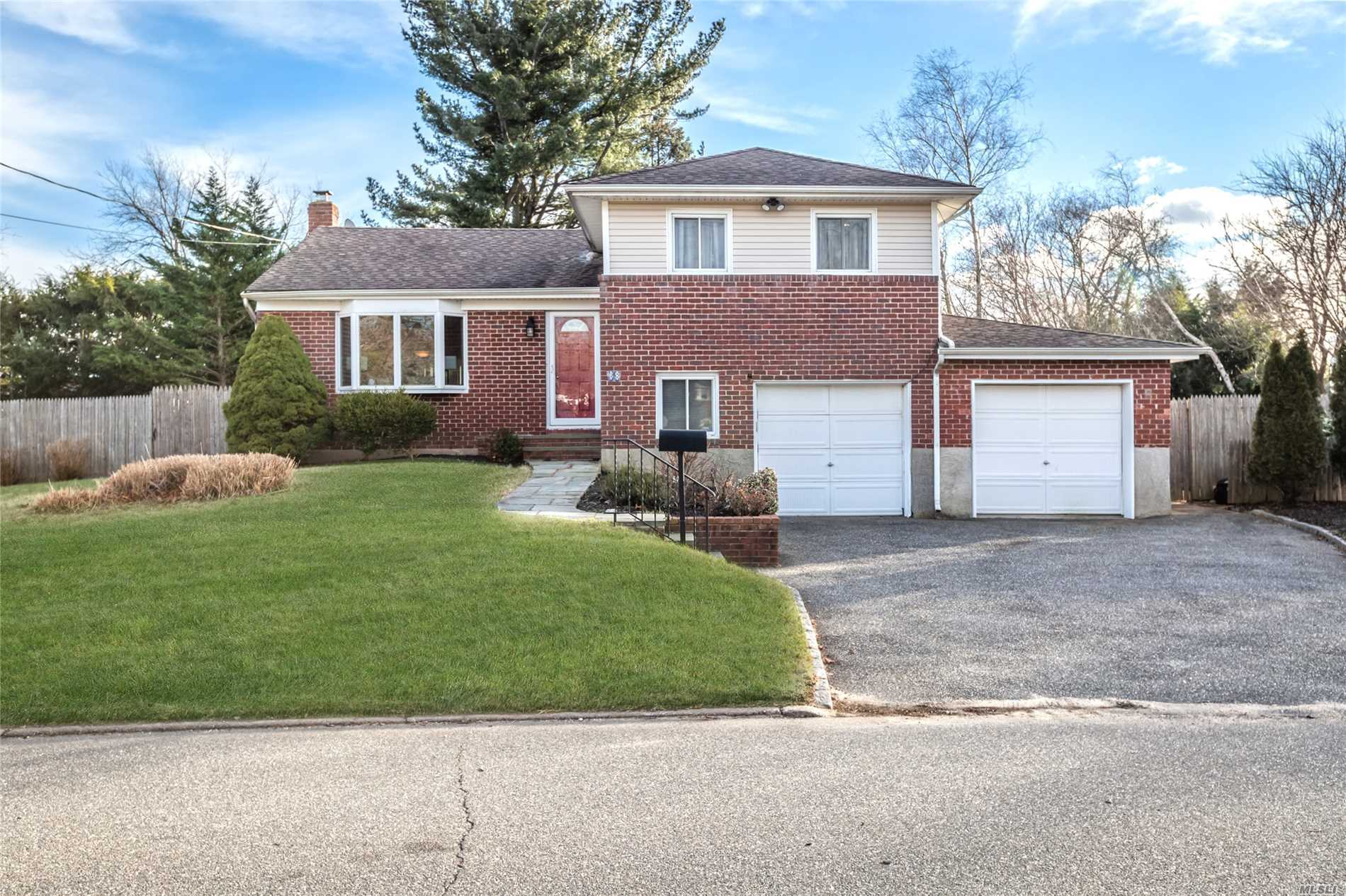 One Of A Kind Split Level Home W/Room For Mom. Vaulted Entry/Lr, Eik W/Maple Cabinets/Granite, Dining Room, Family Room Addition W/Vaulted Ceiling, Slider To Pvt Yard/Paver Patio & Full Bath. Expanded Master Br & Br W/Bamboo Floors, Finished Basement, Garage & More. Mom's Place. Pvt Side Yard Entry, Lr & Dr W/ Vaulted Ceiling, Bedroom, Office/Study, Bath & 2nd Garage. Windows, Roof And Siding Approx.10 Years Old. Cac/2 Zone, Heat/3 Zone, 200 Amp Electric.