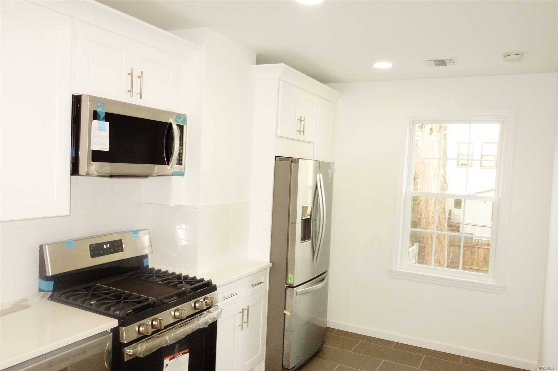 2 Beds Apt On 2nd Fl Of A House. Totally Renovated, All New And Stainless Steel Appliances, New A/C Units,  W/D On The Floor...And ..More.. Zoned Ps 128. Close To M Train And Shops And Juniper Valley Park...Call Now!
