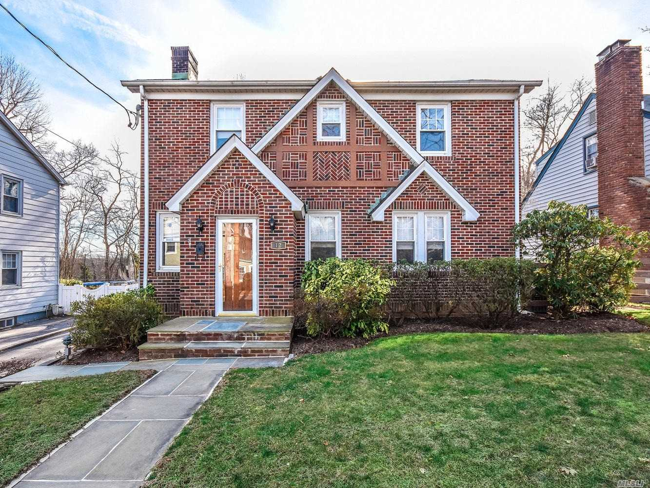 Excited To List This Charming Tudor! It Will Certainly Warm Up Your Winter! These Homeowners Have Kept This Home Meticulously Clean, Organized And Well Cared For. Then There Are The Details That Have Been Part Of The Home From The Beginning...Strong Front Door, Welcoming Arches, Vintage Wood Floors, Stain Glass Windows, Tudor Style Brick Fireplace, Deep Curved Plaster Cove Ceiling Molding & Original Glass/Brass Decorative Door Handles. Enjoy The Beaches, Public Golf Course & Outdoor Concerts!