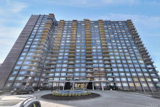 Spacious 2 Bedroom 2 Bath Located In The Beautiful Cryder House On The East River Between The Throggs Neck & Whitestone Bridges,  Unit Has Wood Floors Throughout, Renovated Kitchen , Huge Living Room, Formal Dining Room, 2 Large Bedrooms ,  Main Bathroom Has Been Updated & Master Bedroom Has Extra-Large Entryway Into Renovated Master Bath. Complex Has 24 Hour Security, Doorman & Valet Parking. Heated In-Ground Pool, Gym, Library & Community Room. Laundry On Every Floor For Your Convenience.