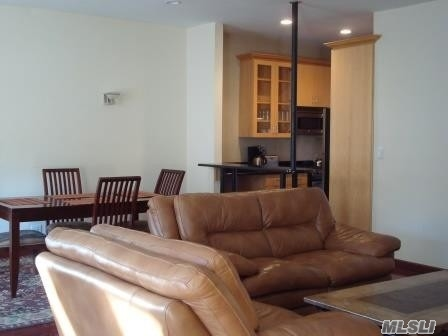 Live In The Heart Of Forest Hills! This Apartment Is All About Luxury And Location. Located 1 Block From The E/F Express (71st/Continental) And The Lirr, This Beautifully Updated Large 2Br/1Ba Has Many Condo-Like Amenities Typically Not Found In A Rental * In-Unit Washer/Dryer * Breakfast Bar * Stainless Steel Appliances * Recessed Lighting * Newly Finished Wood Floors * Windowed Kitchen And Bath * Jacuzzi Tub. A Must-See That's Close To All!