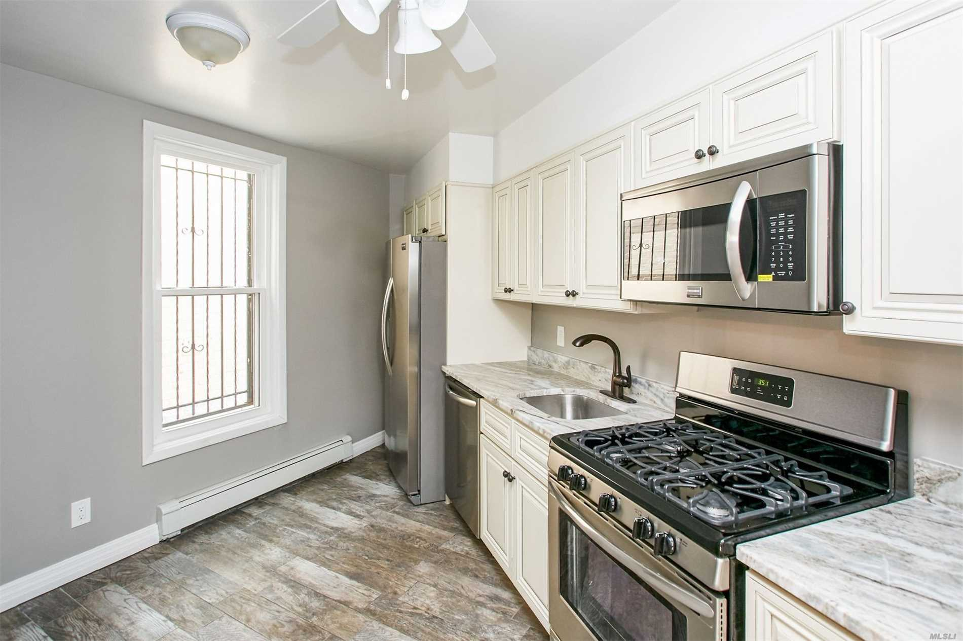 Flawlessly Renovated With New Kitchen, New Bathroom, Refinished Hard Wood Floors And All Fixtures. Spacious & Bright Corner Unit With 2 Large Bedrooms Or Bedroom + Living Room. Heat & Water Included, Tenant To Pay Electric & Cooking Gas. Close To All & Half Block To The Beautiful Forest Park.