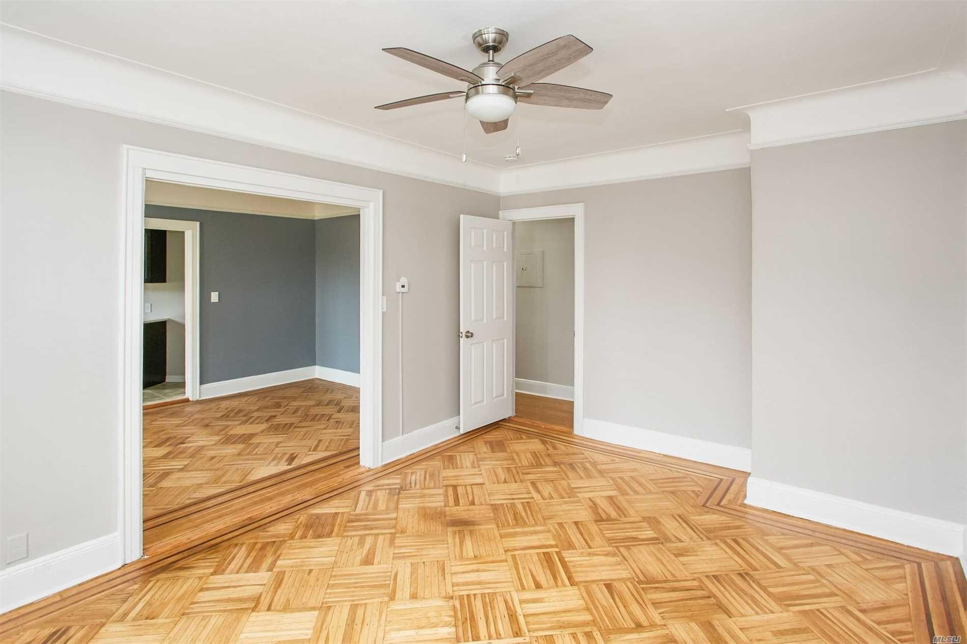 Flawlessly Renovated With New Kitchen, New Bathroom, Refinished Hard Wood Floors And All Fixtures. Spacious & Bright Corner Unit With 2 Large Bedrooms Or Bedroom & Lr. Heat & Water Included, Tenant To Pay Electric & Cooking Gas. Close To All & Half Block To The Beautiful Forest Park.