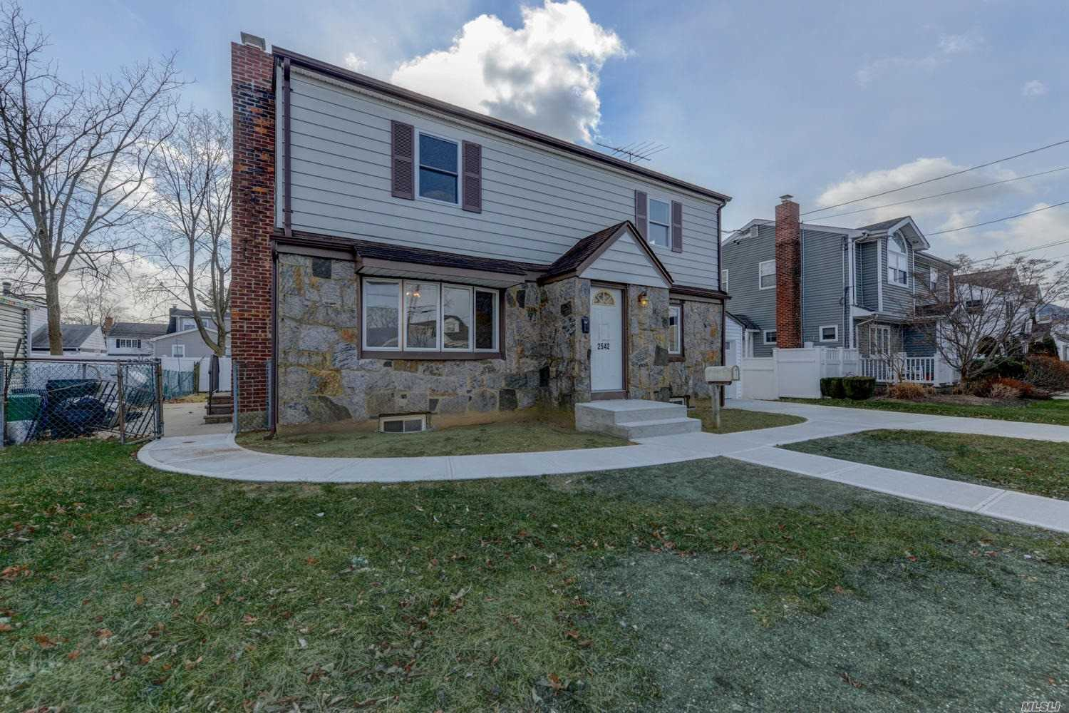 Located Mid Block On A Quiet Street, Large 5 Bdrm Colonial Features New Eat In Kitchen W/Custom Cabinets, Quartz Counter Tops, Ss Appliances, 2 Beautiful Baths, Newly Re Finished Hrd Wd Flrs, Finished Bsmnt W/Tiled Floors, Pvc Fence. Updated Htng Sys, Sidewalks, Driveway, Walkways, Stoops & Patio.Too Much To List Simply Unpack & Immediately Enjoy This Large Move In Ready & Updated Home..