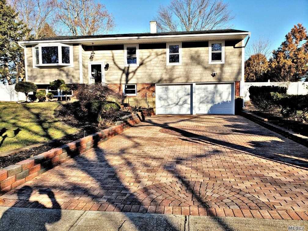 Large Model High Ranch In Valmont Section Of Commack Near Hoyt Farm Park. Totally Renovated New Roof New Siding Paved Driveway Hardwood Floors Throughout