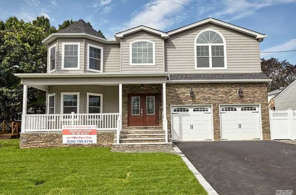 *Photos Shown Are Of The Same Exact Model Home Built Previously By Same Quality Builder. Brand New Large (3550 S.F.) Colonial Is To-Be-Built On Over-Sized Property In Prime Merrick Manor Location! 9' 1st Flr Ceiling, Loaded W/Intricate Trimwork, Custom Wood Kitchen Cabinets & Bathroom Vanities W/ Granite Ctr Tops, Ss Professional Appliances, Huge Bsmt W/ O.S.E., Front Porch & Walkway Done In Pavers, +So Much More! Premium Energy-Efficient New Home Built By Builder Of 25+ Years & Over 350 Homes!