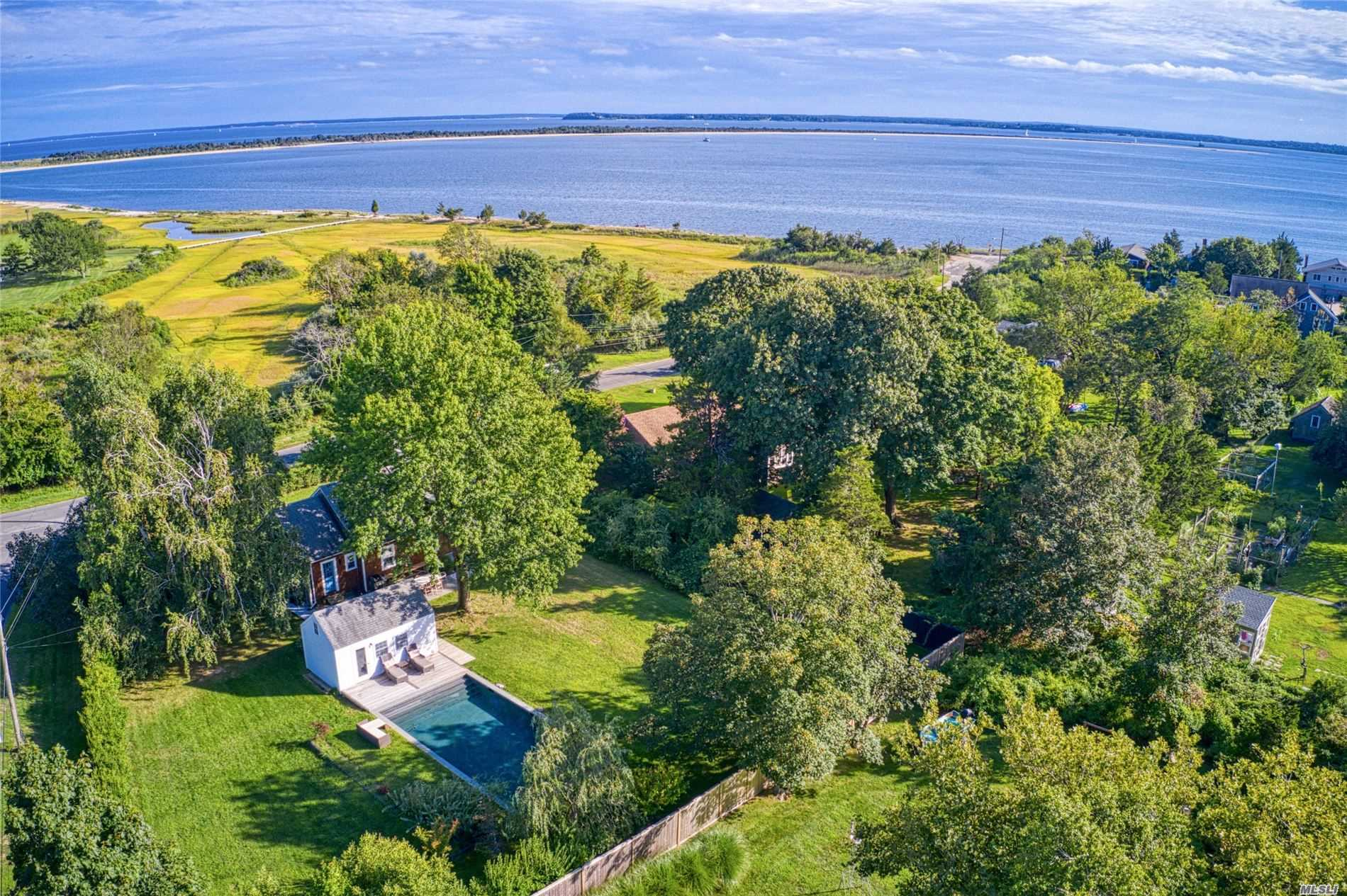 Orient Village- Newly Renovated Cedar Shingled 3-4 Bedrooms, 2 New Baths , Fireplace, Central Ac, On 1/2 Acre With Pool House, New Gunite Pool And Fully Fenced In Yard Located In Coveted Orient Village Only Steps To 2500 Feet Of Orient Harbor Beach.