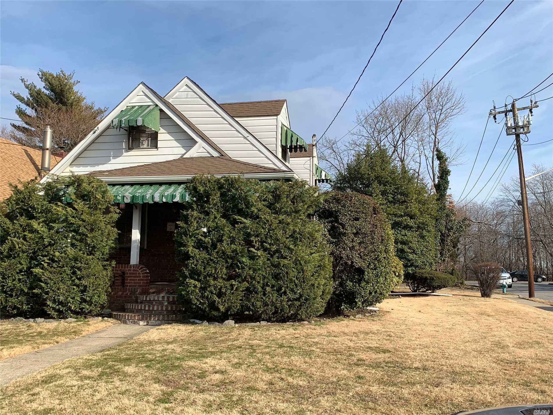 Needs Work, Great Location, Corner Property With Plenty Of Parking, 4 Big Bedrooms, 2 Full Baths Including One In The Finished Basement With Side Entrance Priced To Sell, Won't Last!