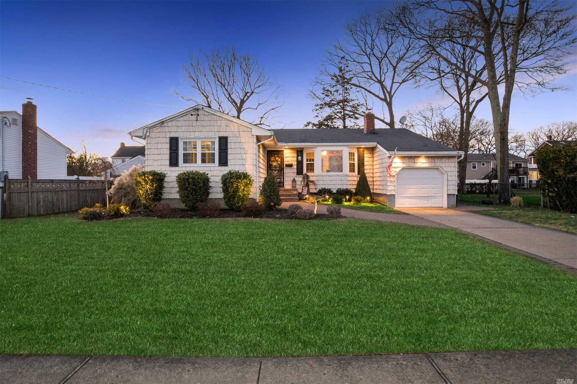 Beautiful Ranch In The Heart Of Massapequa Park, Walking Distance To Town And Railroad. Spacious 3 Bedroom Ranch, Updated Kitchen With Ss Appliances, Formal Dining Room, Living Room W/ Frpl, 3 Bedrooms, 1.5 Baths, And Attached 1 Car Garage. Very Large Basement With Laundry, Storage, Etc. Nice Size Lot With Large Deck & Patio For Entertaining And Large Lawn Area As Well. A Must See!!